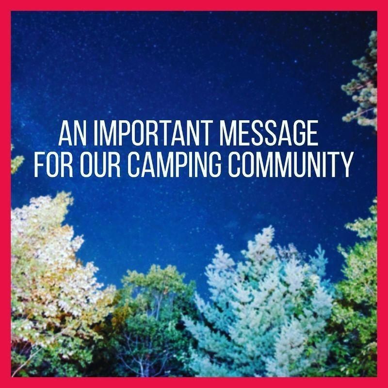 Nighttime treeline with 'An Important Message for our Camping Community' written in the sky