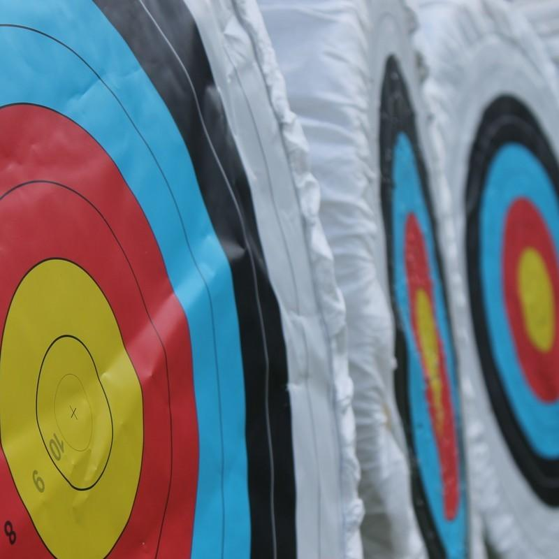 Archery targets with yellow, red, and blue bullseyes